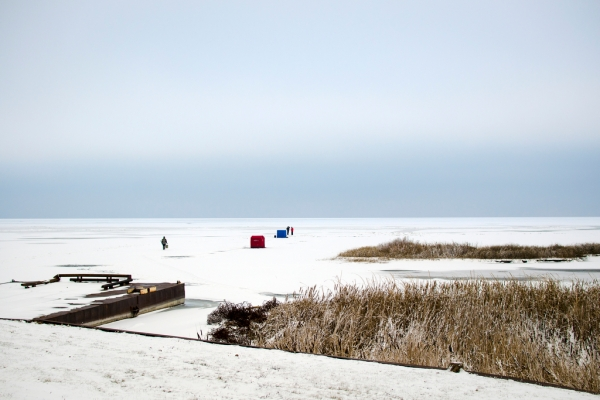 Danielle McGrew | MLive.com A handful of shanties and ice fishermen dot the edge of the Saginaw Bay in Linwood on Friday, Nov. 29. The day's high was 25 degrees.