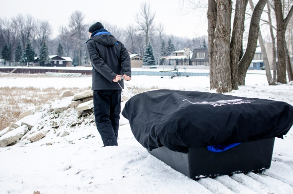 Danielle McGrew | MLive.com Ryan Weiss, 17, of Bay City, drags a shanty to the frozen Saginaw Bay in Linwood on Friday, Nov. 29. The day's high was 25 degrees.