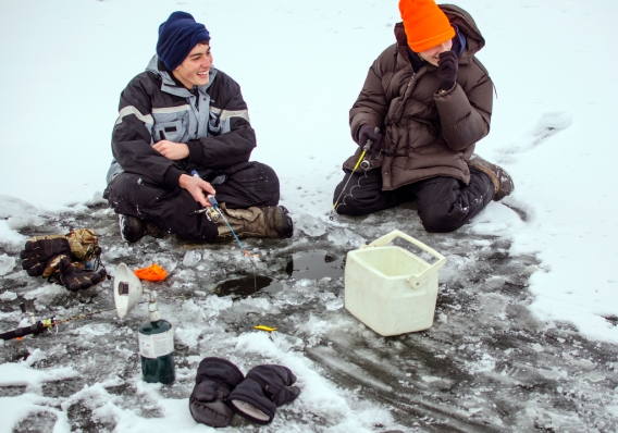 Danielle McGrew | MLive.com Josh Appold and Rylan Appold, both 17 and from Bay City, laugh as they joke across the ice with their friends Ryan Weiss and Jonny Engelhardt as they fish on the Saginaw Bay in Linwood on Friday, Nov. 29. The group said it was the first time they were able to go ice fishing this season.