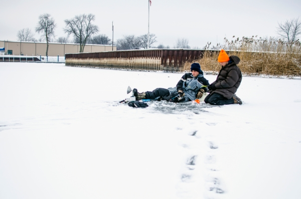 Danielle McGrew | MLive.com Josh Appold and Rylan Appold, both 17 and from Bay City, fish on the Saginaw Bay in Linwood on Friday, Nov. 29. The day's high was 25 degrees. The group said it was the first time they were able to go ice fishing this season.